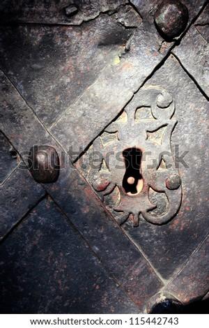Old lock in the ancient doorway - stock photo