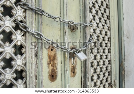 Old lock on the door. lock on the door of an old house . - stock photo