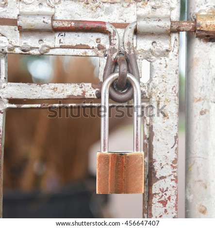 Old lock on the door of an old color. close-up focus on lock retro metal on a classic hanging. - stock photo