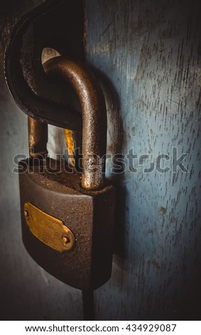 Old lock on the door of an old house gray color. close-up focus on lock retro metal on a classic hanging. - stock photo
