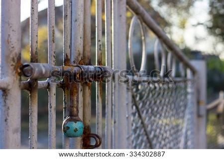 Old lock on the gate - stock photo