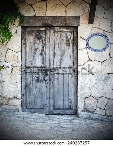 Old locked colonial doors of mexican hacienda - stock photo