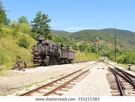 Old locomotive on Shargan eight railway, Serbia - stock photo