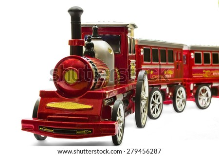 old locomotive, toy of child for development, history of steam technique   - stock photo