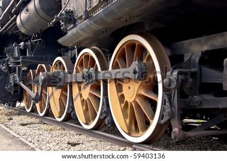 Old locomotive wheels close up. Steam train. - stock photo