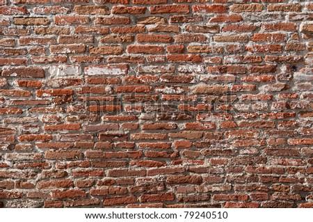old long narrow worn down bricks make a wall - stock photo