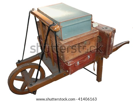 Old luggage trolley on white - stock photo