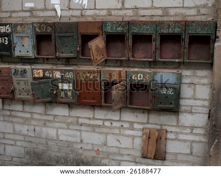 Old mail boxes in China.There are for different family in this building. - stock photo
