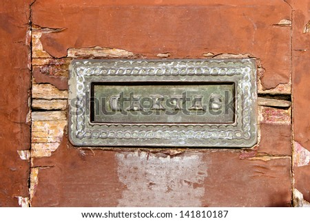 old mail slot in a wooden door in Porto, Portugal - stock photo