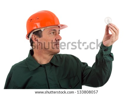 old man electrician in uniform with bulb. Isolated on white - stock photo