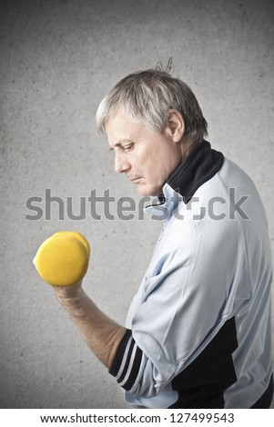 old man is training with exercises - stock photo
