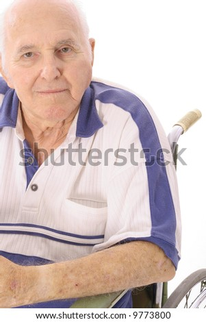 old man sitting in wheelchair - stock photo