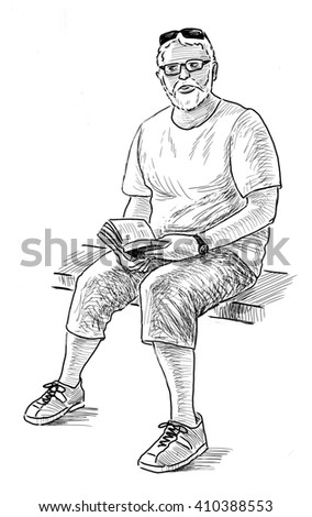 old man with a book - stock photo