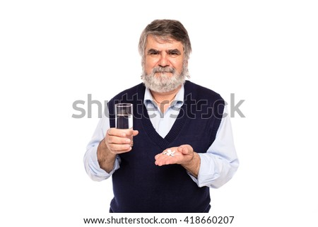 old man with gray beard having a glass of water and pills in hands, isolated on white - stock photo
