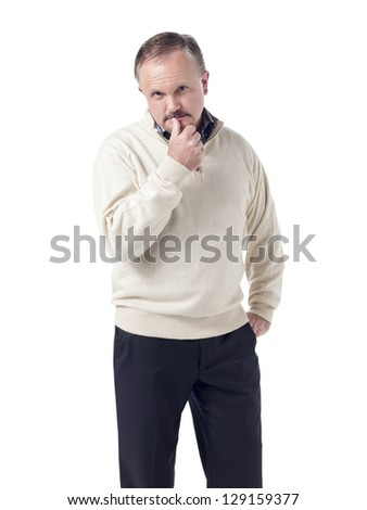 Old man with hand on his pocket and looking at the camera - stock photo