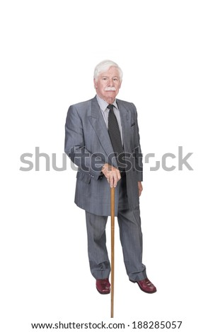 old man with walking stick in a grey suit - stock photo