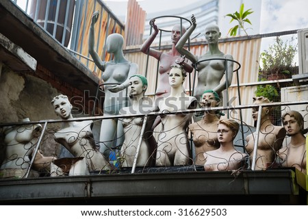Old mannequins on the roof of a building in the Arab quarter (Kampong Glam) Singapore. - stock photo