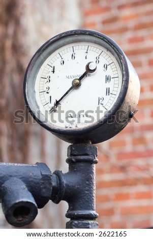 Old manometer on a ship motor. - stock photo