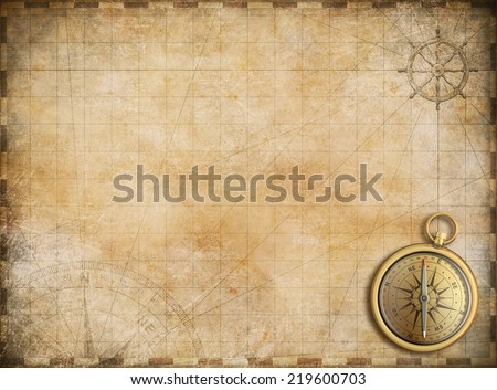old map with brass compass as exploration and adventure background - stock photo