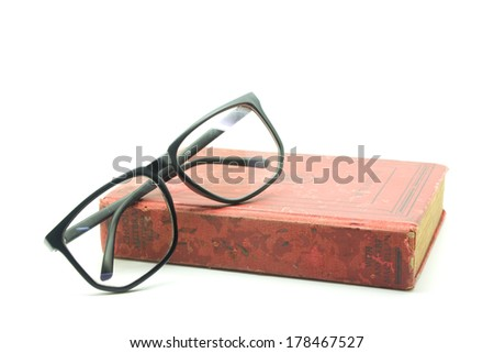 Old math book and  glasses isolated on white - stock photo