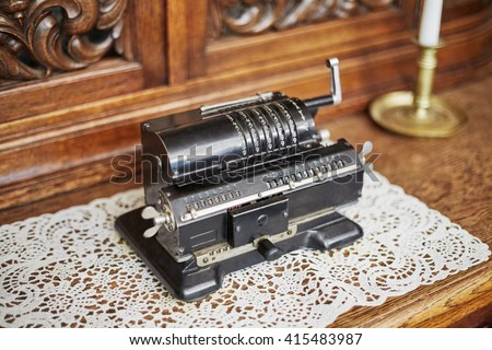 Old mechanical manual counting machine for arithmetical calculations. - stock photo