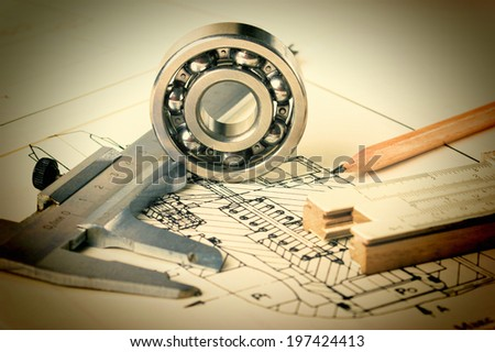 Old mechanical scheme and calipers with bearing - stock photo