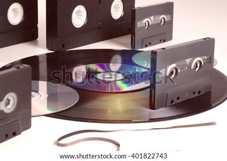 Old media formats, vinyl, VHS tapes, audio tapes and CD  - stock photo