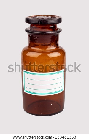 Old medicine bottle with blank label - stock photo