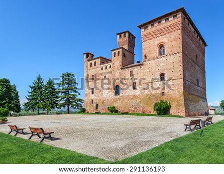 Old medieval castle in small town of Grinzane Cavour in Piedmont, Northern Italy. - stock photo