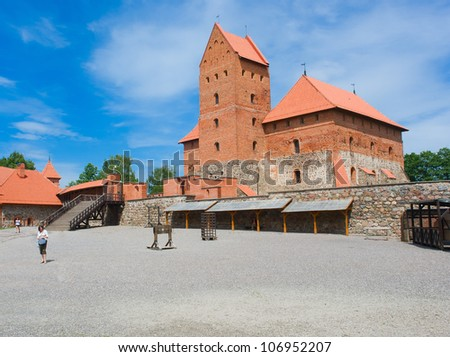 Old medieval castle on lake Galve in Trakai, Lithuania - stock photo
