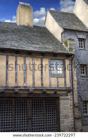 Old medieval facades of historical houses in France - stock photo