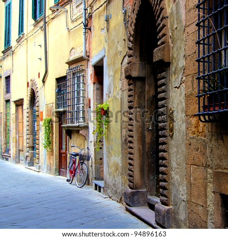 Old medieval street in Tuscany, Italy - stock photo