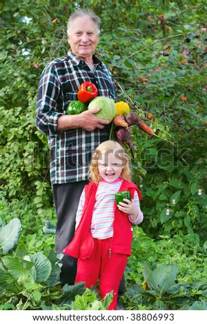 old men and girl in garden - stock photo