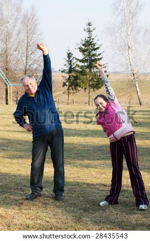 old men with girl outdoor - stock photo