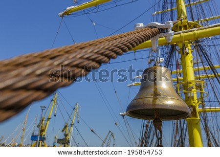 Old metal alarm bell of an moored tall ship. - stock photo
