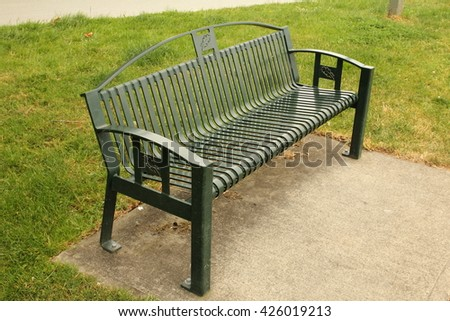 old metal bench in the park - stock photo