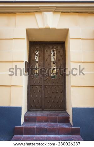 old metal door in the streets of Lviv. - stock photo