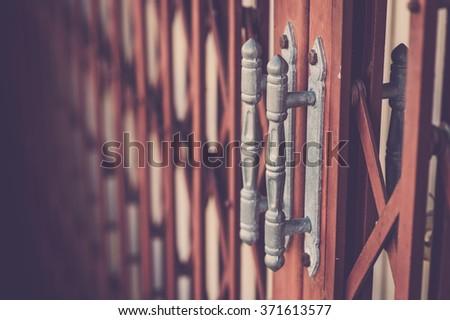 Old metal door. Vintage filter. - stock photo