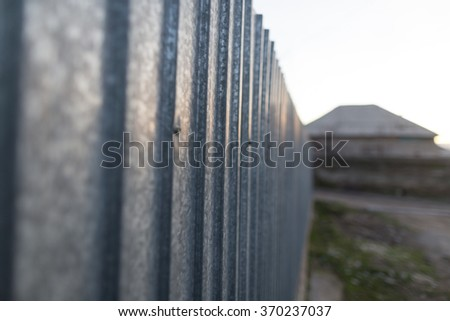 old metal fence as a backdrop - stock photo