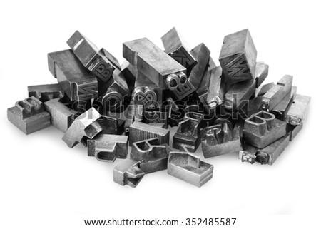 Old metal letterpress printing blocksth - stock photo