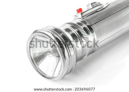 Old metal pocket flashlight isolated on white background - stock photo