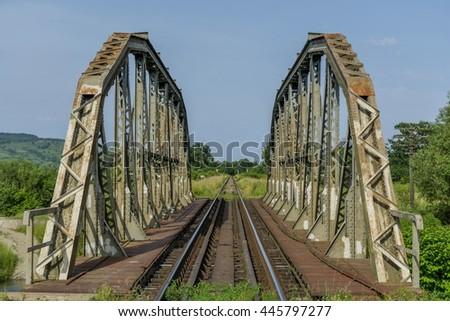 Old metal railroad bridge - Entrance view - stock photo