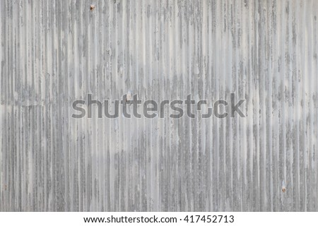 old metal sheet zinc wall texture with peeling paint - stock photo
