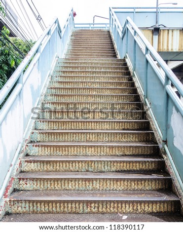 Old metal stairs of the overpass in the city. - stock photo