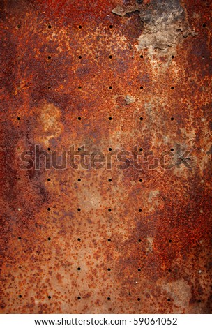old metal texture with round holes - stock photo