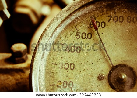 Old meter for measuring pressure - duo tone - stock photo