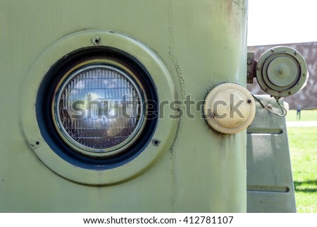 old military car headlight reflector, rusty grid - stock photo