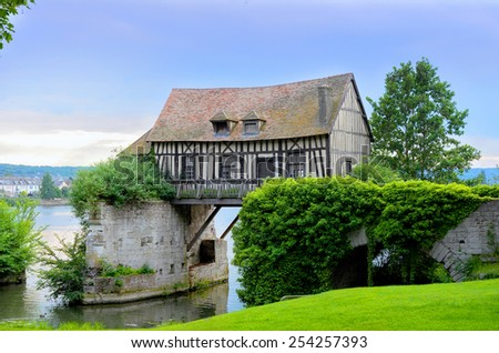 Old mill house on bridge, Seine river, Vernon, Normandy, France  - stock photo