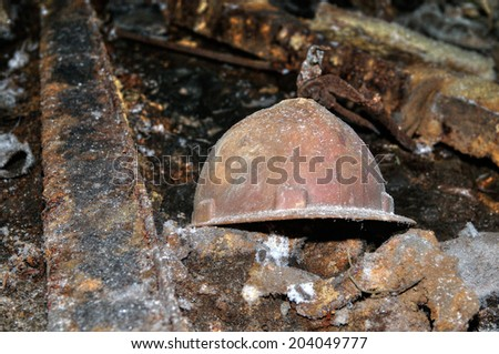 old miner's helmet in an abandoned mine - stock photo