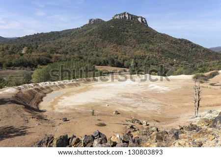Old mines area under blue sky - stock photo